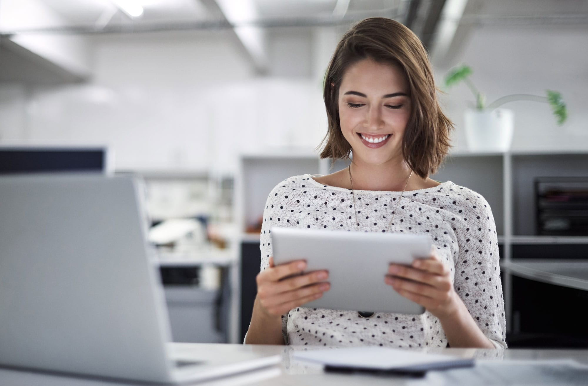 woman-looking-down-at-tablet